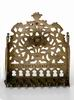 Hanukkah lamp adorned with row of gates, foliage and <i>Hamsah</i>