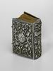 Miniature prayer book with silver binding adorned with Levi family emblem